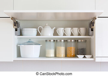 opened cupboar with kitchenware inside