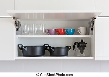 kitchenware - opened cupboard with kitchenware inside