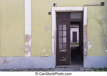 Opened door to the yard of an old house
