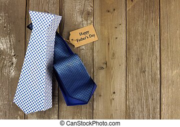 Opened Fathers Day handmade tie shaped gift box with tag on a rustic wood background
