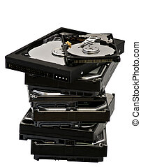 opened hard disk drive lying on other hard drive