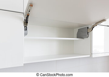 opened kitchen cabinet - opened white kitchen cabinet with...