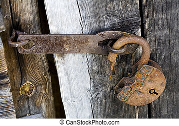 opened lock - Old opened rusty and dirty metal lock on a old...