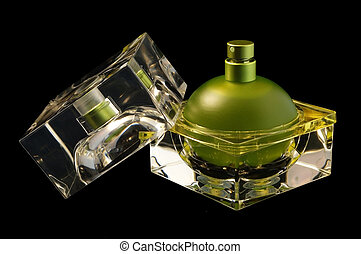 Opened perfume bottle over black - An open perfume bottle ...