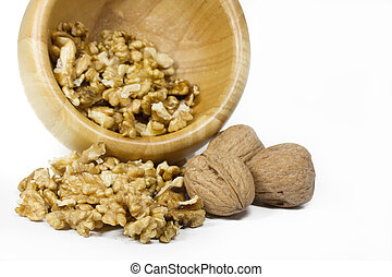Walnuts in a bowl on white background