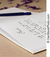 Opened wedding guest book with a pen