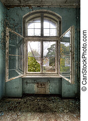 opened window in an abandoned hospital
