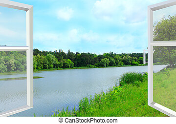 opened window with view to summer landscape with forest and lake