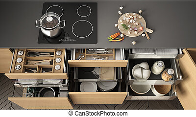 Opened wooden kitchen drawer with accessories inside,...