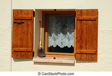 Opened wooden window shutters