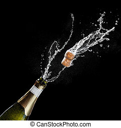 Opening a bottle of champagne. The celebration theme with splashing champagne isolated on black background. Traffic's flying.