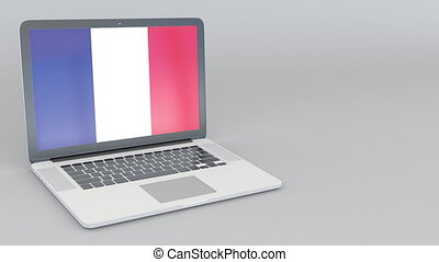 Opening and closing laptop with flag of France on the screen...