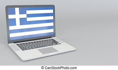 Opening and closing laptop with flag of Greece on the screen...
