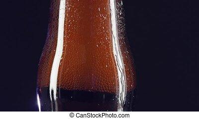 Opening bottle, slow motion, cam moves upwards, spray,...