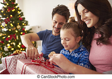 Opening Christmas present with parents