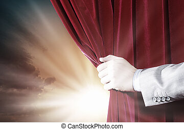 Opening curtain - Close up of hand opening red curtain....