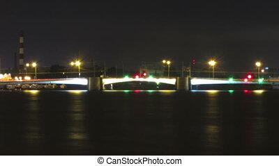 opening drawbridge at night in St. Petersburg Russia -...