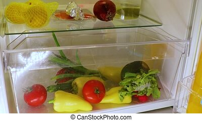 Opening fridge for food - Grabbing vegetables from the...