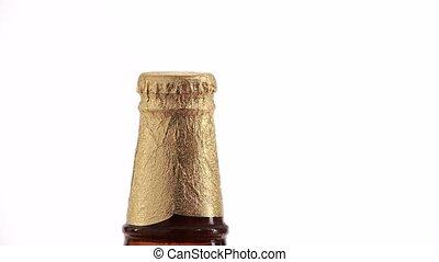 opening golden beer bottles