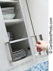 Opening kitchen cabinet door