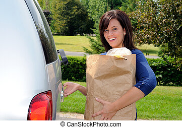 Opening Tailgate - Pretty Young Woman Opening The Tailgate...