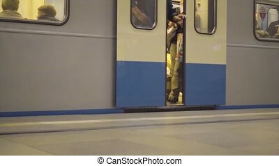 Opening the doors of the train arriving at the metro station