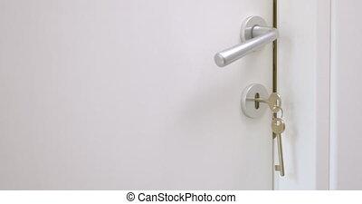 Opening the Room Door - Closeup shot of door handle and keys...