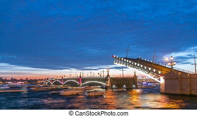 Opening Trinity bridge timelapse and pleasure boats are on Neva river in Saint-Petersburg, Russia.