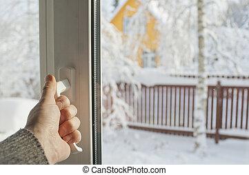 Opening Window In Winter