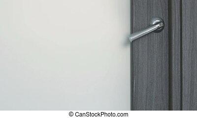 Opens the door and walks in