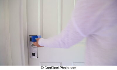Opens The Door Of Her Hotel Room With An Electronic Key Card
