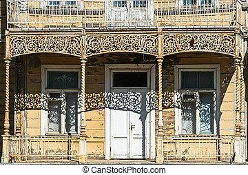 Openwork balcony fence in the old house in Peterhof.