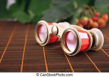 Opera glasses on a bamboo napkin