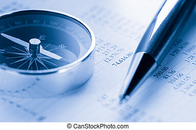 Operating budget, compass and pen