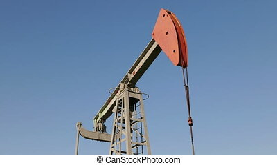 Operating oil and gas well in oil field, profiled against...