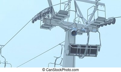 Operating ski chairlift in the fog - Mountain ski slope...