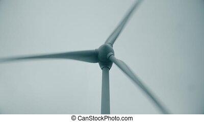 Operating wind turbine, low angle close-up shot - Operating...