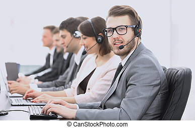 operator call center with colleagues sitting at the...