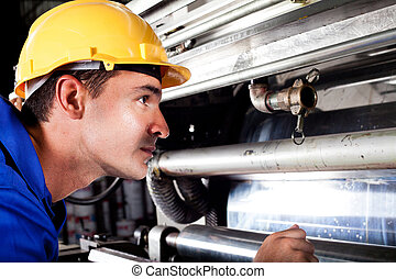 operator checking on machine - industrial machine operator...