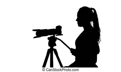 Operator controls the camera. White. Silhouette - Young...