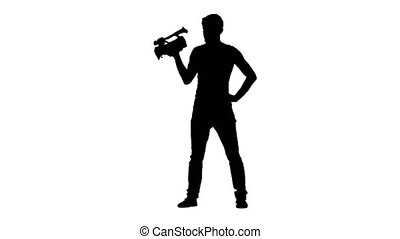 Operator holds the camera in hands and looking at time - Man...
