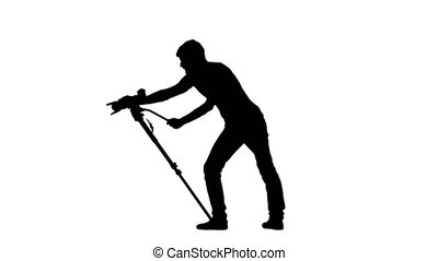 Operator is working in studio with the camera. Silhouette. White