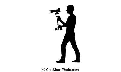 Operator makes shooting turning around itself. Silhouette....