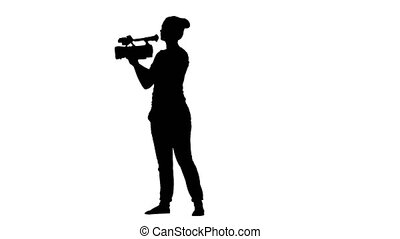 The operator in the process of standing in one place, looking into the viewfinder and the camera turns 180 degrees. Silhouette. Isolated on white background