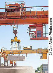 Operator of crane works at finished good warehouse