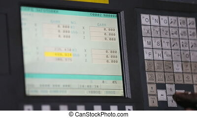 operator presses on the keyboard of the machine