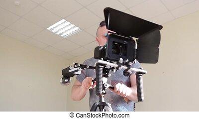 An Operator Shooting On DSLR Kit HD