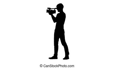 Operator walking with camera and shooting film. White....