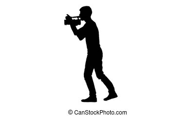 Operator works. Video camera in his hands. White background. Silhouette