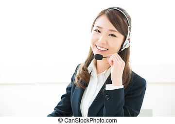 Operator - young attractive asian woman who works as an...